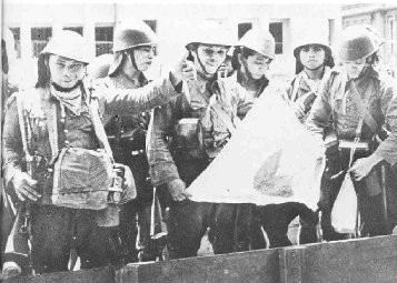 Dutch soldiers with a captured Japanese flag