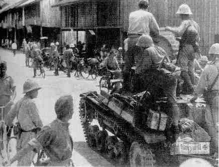 Japanese tanks with infantry entering Batavia, March 1942