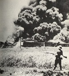 The oil tanks burning at Palembang, Sumatra Island in 1942